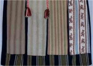 Särna/Idre kjol med fyra olika förkläden och band.